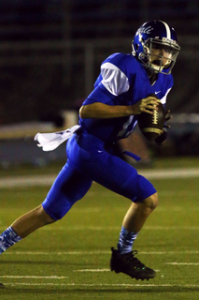 Quarterback P.J. Hurst rolls out to find an open receiver in Palisades'  61-7 victory over Fairfax on Senior Night.          Rich Schmitt/Staff Photographer