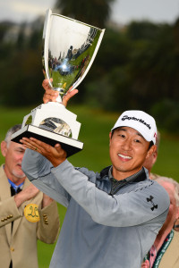 James Hahn lifts the trophy after winning the Northern Trust Open on the third playoff hole Sunday at Riviera Country Club. Rich Schmitt/Staff Photograher
