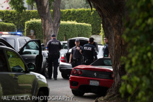 Police surround a Mercedes in Pacific Palisades after chasing it from Venice. Photo: Al Alicea